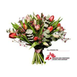Bukett med tulpaner, vaxblomma och eucalyptus. Skicka blommorna med bud via Interfora!