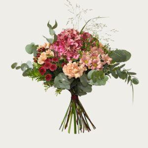 Interfloras septemberbukett, med hortensia, santini, nejlika och grönt. Höstrosa, aprikosa o. vinröda färgtoner. Skicka blommorna med bud - beställ enkelt online.